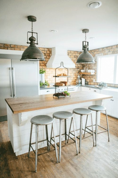 New honed black granite countertops were added along with a new farm sink, fixtures, lighting, cabinets and floating cedar shelves. Clint Harp crafted an island that Joanna designed for the Kings using some shiplap found on one of the original walls.