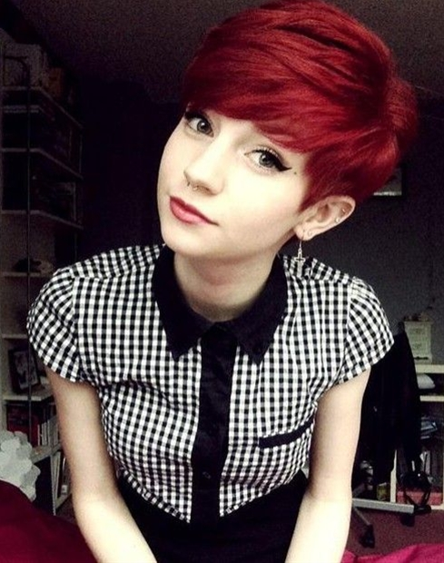 The amazing pixie features brilliant red tones and fine smooth hair lays neatly along the sides of the face looks luscious.