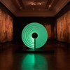 Candela installation creates luminous patterns as it spins inside dark V&A gallery