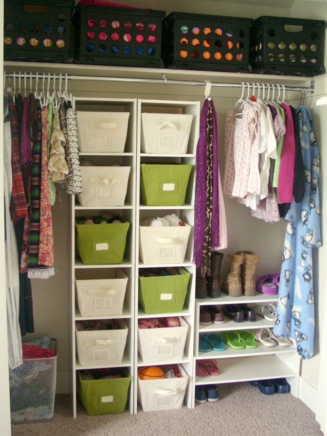You've seen her closet before (probably twice) but it functions well for her and she's been able to keep it neat and organized and that's saying a lot. I'm making some new baskets for the top shelf that I'll be sharing soon.