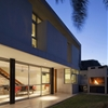Confined Argentinian Home Arranged Around a Small Courtyard Illuminating Modern Spaces
