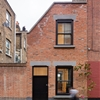 Old upholsterer's workshop in London transformed into a narrow brick home
