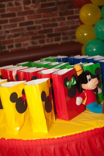 DIY treat sacks... multi-colored paper bags and Mickey cutouts!