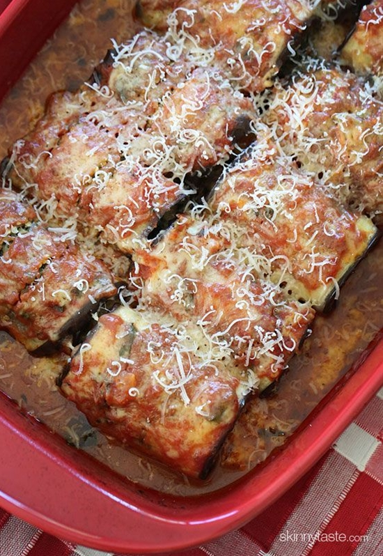 INGREDIENTS: 2 medium Italian eggplants cut lengthwise into 10 (1/4-inch thick) slices (21 oz total when sliced), kosher salt and fresh black pepper to taste. 1 1/2 cups quick marinara sauce, 1 large egg, 1/2 cup part skim ricotta cheese, 1/2 cup grated Pecorino Romano cheese plus more for serving, 8 oz frozen spinach heated through and squeezed well, 1 garlic clove minced, 1 cup (4 oz) shredded part-skim mozzarella (Polly-O).