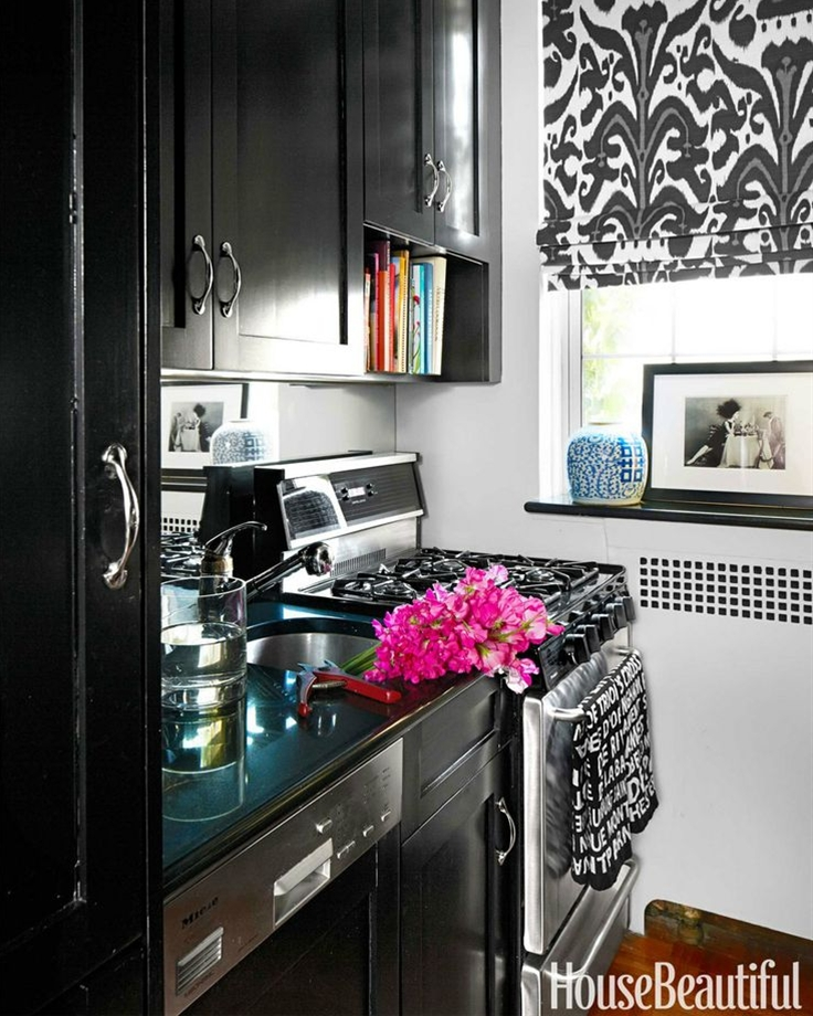 """The existing kitchen cabinets were painted Benjamin Moore Aura in Black. """"I wanted it to look less boring and more like a smart butler's pantry,"""" Bunn says. Roman shade in Holland & Sherry's Belfour linen."""