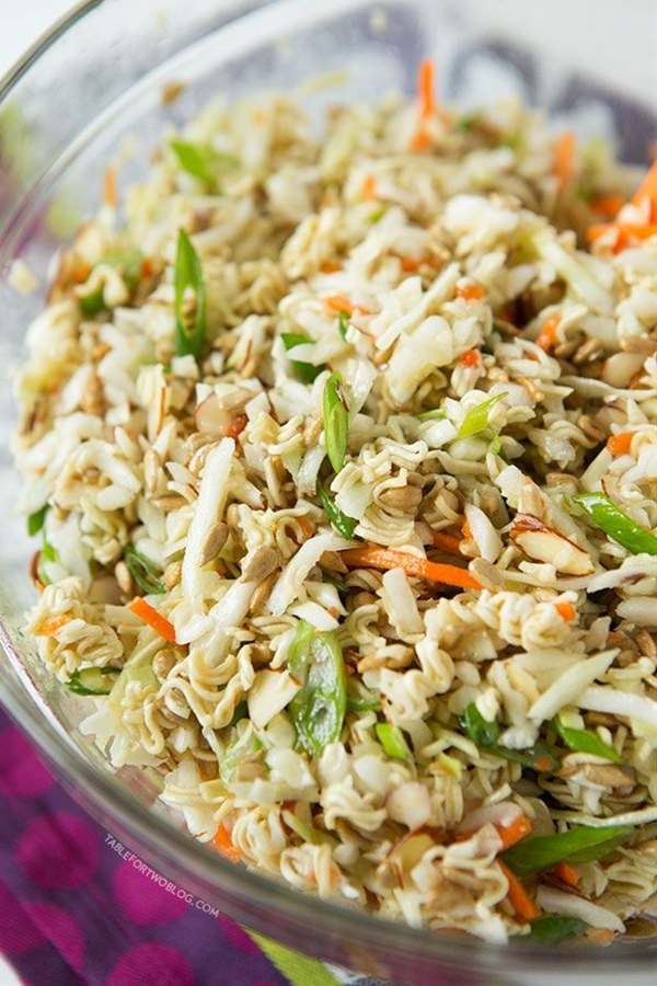 INGREDIENTS: 1 (16 ounce) bag coleslaw mix, 1 cup sunflower seeds (de-shelled/shelled/no shells), 1 cup Diamond of California sliced almonds, 2 (3 ounce) bags ramen* (any flavor, you won't be using the seasoning packets so it doesn't matter), 5 stalks of scallions sliced, ¾ cup vegetable oil, ⅓ cup white vinegar, ½ cup granulated sugar.
