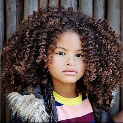 This little girl is so cute and has a ton of thick curly hair...glad I don't have to worry about combing it every day.lol  natual hair styles for black women