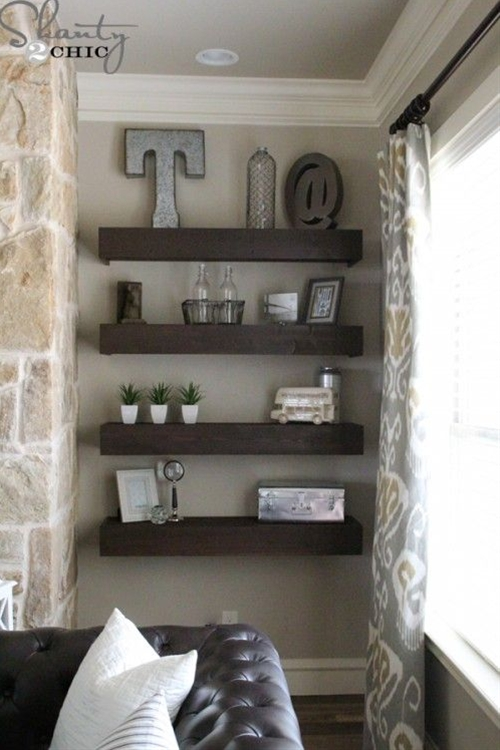 I built the 8 floating shelves you see there for only 120 Bucks!!!  Each shelf is 4 ft. long and 12 in. deep!  How amazing is that
