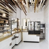 Inviting Bakery Design in Warsaw Exhibiting an Eye-Catching Plywood Installation