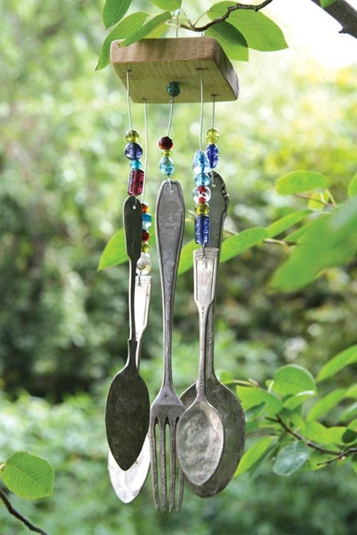A handmade wind chime, fashioned from old utensils and colorful beads, adds whimsy and with a gentle breeze soothing sounds.