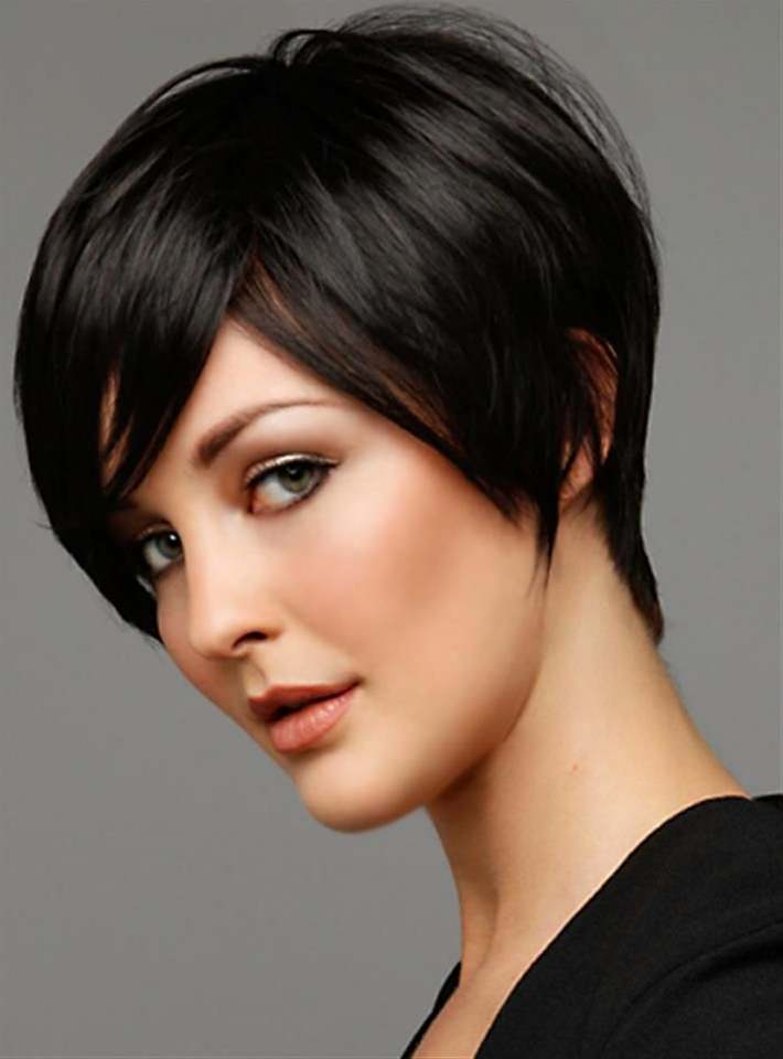Here is another elegant style for short hair While you hair are still moist make a deep side part with the help of comb. Use medium sized brush for blow dry. After this step immediately use a straightening iron over large sections of hair. Use shiny spray onto them.
