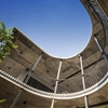 Eleena Jamil's Vermani House features raw concrete, a courtyard and a slide