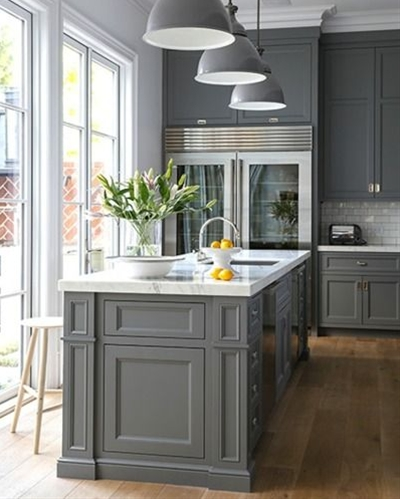 Interior designer, Susan Greenleaf's kitchen is truly to die for. Clean lines meet traditional elements, all in the most perfect shade of gray.