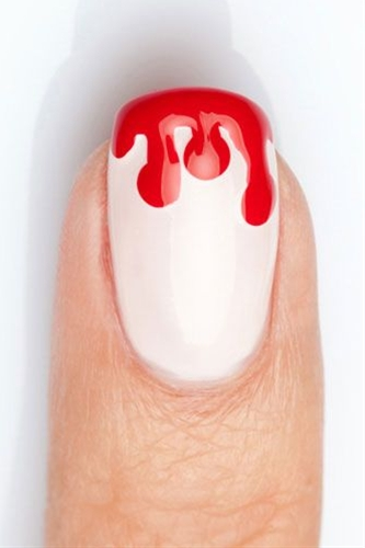 This bloody nail design is a subtle way to show your Halloween spirit this season!