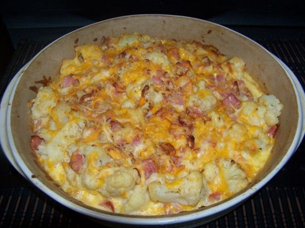 Ingredients: 1 pound ham,  1 16 oz bag frozen cauliflower, or mix with broccoli,  2 cups taco cheese, shredded,  1 egg,  ½ cup almond milk,  ¼ cup heavy cream,  1 Tablespoon dried minced onion,  1 teaspoon garlic powder,  ¼ cup crushed pork rinds, optional.