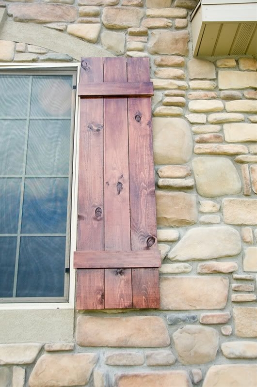 This is the style of shutters I want for our house. I'm thinking we could use some old wooden pallets to make them.